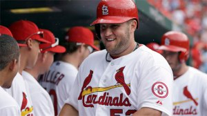 St. Louis Cardinals' Matt Adams is congratulated by teammates in the dugout after hitting a two-run home run during the sixth inning of a baseball game against the Cincinnati Reds on Wednesday, April 10, 2013, in St. Louis. The Cardinals won 10-0. (AP Photo/Jeff Roberson)