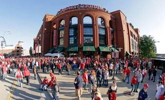 Fans walks outside of Busch Stadium before Game 3 of baseball's World Series between the Boston Red Sox and the St. Louis Cardinals Saturday, Oct. 26, 2013, in St. Louis. (AP Photo/Charlie Riedel)