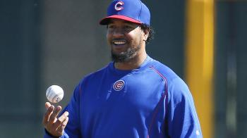 Chicago Cubs hitting consultant Manny Ramirez watches workouts during a spring training baseball practice, Wednesday, Feb. 25, 2015, in Mesa, Ariz. (AP Photo/Matt York)